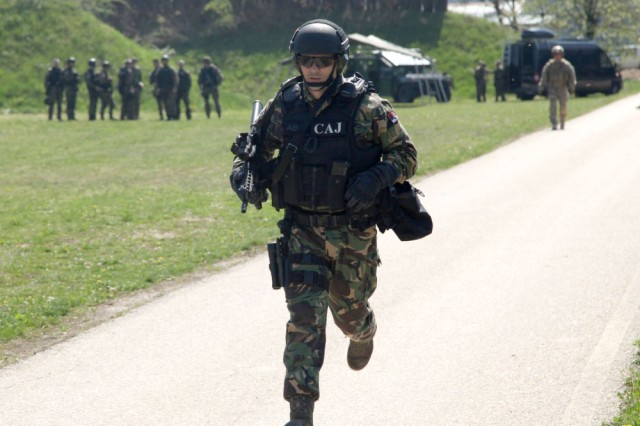 A Serbian special anti-terrorist unit officer runs to the first station of a shooting exercise during joint combined exchange training with U.S. and Slovenian special operation forces at the SAJ headquarters complex in Serbia, April 10, 2017. The Serbian unit, known as the SAJ, serves as a special operations and tactical unit of the Serbian police and will receive training in a variety of tactics and techniques over the course of the JCET to increase their effectiveness in future operations.