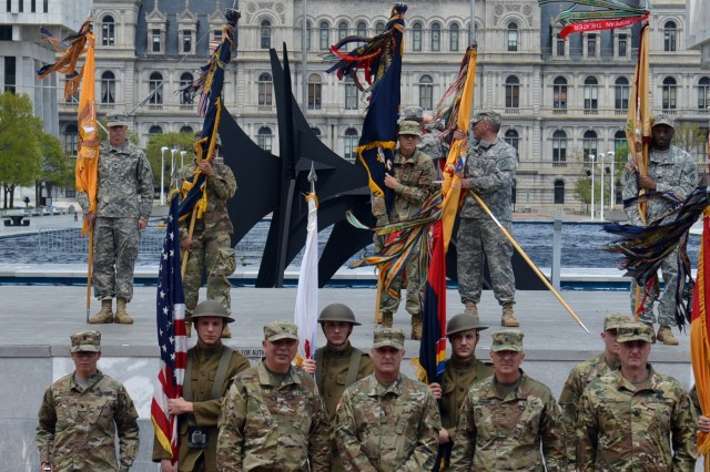 With the New York State Capitol in the background, key leaders of the New York Army National Guard and the 42nd Infantry Division pose following change of command ceremonies at the Empire State Plaza in Albany, N.Y. on May 6, 2017. They are, from left, Brig. Gen. Raymond Shields, Assistant Adjutant General for Army; Major General Harry Miller, the outgoing commander of the 42nd Infantry Division; Brig. Gen. Steven Ferrari, the incoming commander of the 42nd Infantry Division; and Command Sgt. Major Justin Lenz, 42nd Infantry Division Command Sgt. Major. ( U.S. Army National Guard photo by Lt. Col. Roberta Comerford)
