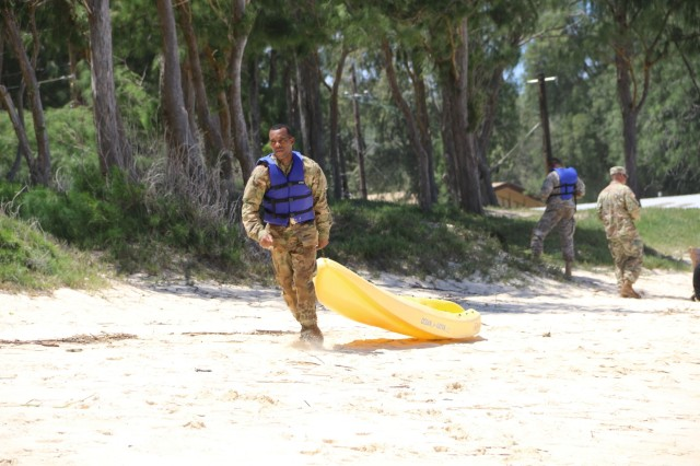 A Soldier pulls a kayak through the sand as part of a timed tasked during Regional Health Command-Pacific's Best Warrior competition which took place May 1-5 at various locations around the island of Oahu, Hawaii.