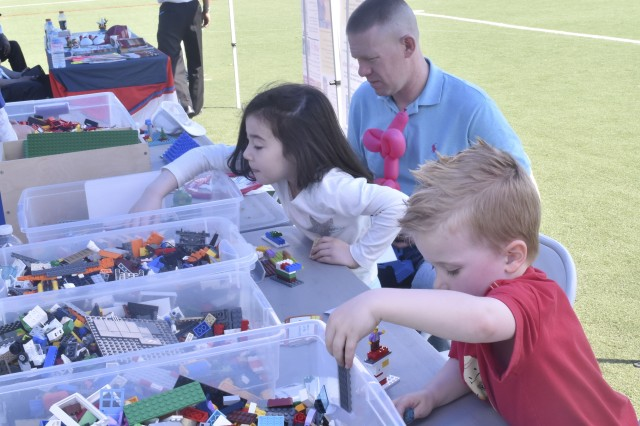 Children use blocks to create during the Maker's Family Experience event at the Camp Walker Kelly Field on Apr. 29.