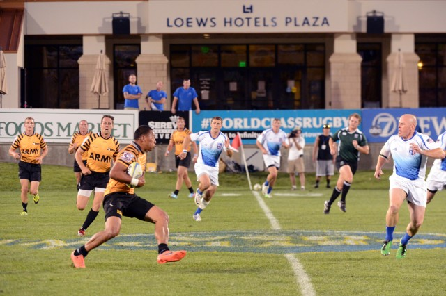 Mattie Tago advances the ball during All-Army's last-minute march to a 19-14 victory over All-Air Force in the gold-medal game of the 2013 Armed Forces Rugby Sevens Championships at Infinity Park in Glendale, Colorado, with Capt. Andrew Locke in tow (immediately left of Tago). The U.S. Army World Class Athlete Program Soldiers are featured in the 2017 Army Strong B.A.N.D.S. campaign. Locke also served as an assistant coach for the 2016 U.S. Olympic women's rugby team. Army Strong B.A.N.D.S. is back with the largest Army Family and Morale, Welfare and Recreation campaign of the year, pushing Soldiers, their Families, and Department of Defense civilians to focus on balance, activity, nutrition, determination and strength -- to get up, get out, get busy exercising, eat better, and commit to a healthier lifestyle.