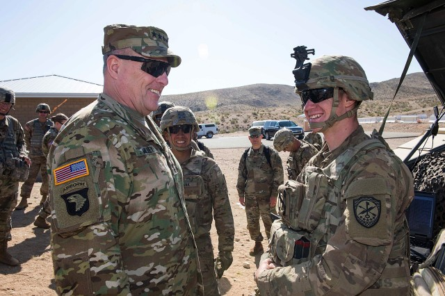 Army Chief of Staff Gen. Mark A. Milley talks with Soldiers of the 780th Military Intelligence Brigade during a visit to the National Training Center at Fort Irwin, Calif., May 9, 2017. The Soldiers, members of the brigade's Cyber Electromagnetic Activities (CEMA) Support to Corps and Below (CSCB) Team, are conducting CEMA in support of a training rotation by the 2nd Armored Brigade Combat Team, 1st Infantry Division, as part of the Army Cyber Command-led CSCB initiative to help the Army define expeditionary cyber capabilities and their integration into maneuver unit planning processes.