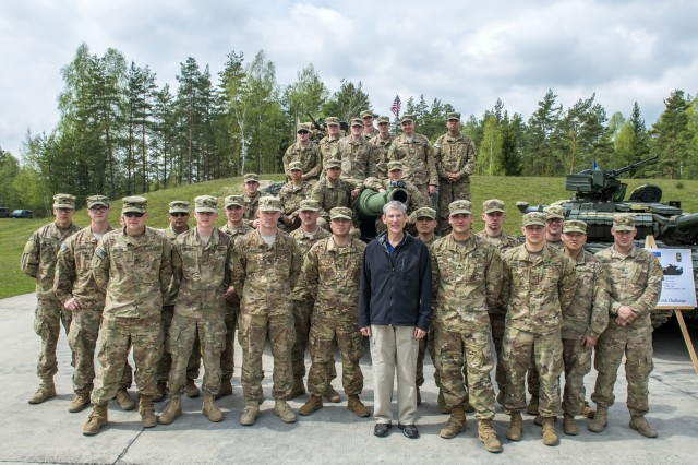 Acting Secretary of the Army Robert Speer visits with 2nd Armored Calvary Soldiers during the Strong Europe Tank Challenge, at the 7th Army Joint Multinational Training Command's Grafenwoehr Training Area, Germany, May 7, 2017.