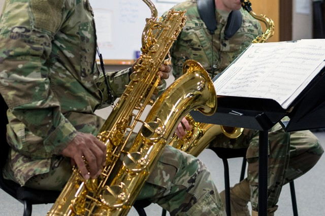 Cpl. Devin Thomas and Spc.Christopher Blue, 399th Army Band saxophone players, rehearse for the upcoming joint concert scheduled for Wednesday in St. Louis.