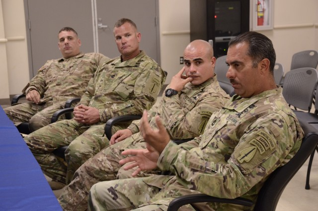 Members of the U.S. Army Special Operations Command parachute team Black Daggers, left to right, Sgt. 1st Class Allan Baros, Sgt. 1st Class Aaron Pigel, Sgt. 1st Class Jonathan Morales and Master Sgt. Travis Alfred, met with leaders in 3rd Battalion, 13th Infantry Regiment for a Leader Professional Development session.