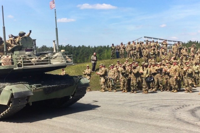 Soldiers of 3rd Armored Brigade Combat Team, 4th Infantry Division, cheer on a brigade tank platoon from the unit's 1st Battalion, 66th Armor Regiment, as the crews conduct offensive operations during the Strong Europe Tank Challenge at Grafenwoehr Training Area, Germany, May 10, 2017. The competition is designed to project a dynamic presence, foster military partnership, promote interoperability, and provide an environment for sharing tactics, techniques and procedures among armor platoons from Austria, France, Germany, Poland, Ukraine and the U.S. (U.S. Army photo by Capt. Scott Walters, 3rd Armored Brigade Combat Team, 4th Infantry Division)