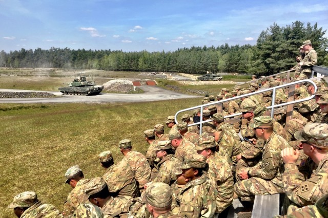 Soldiers from 3rd Armored Brigade Combat Team, 4th Infantry Division, watch tank crews from 1st Battalion, 66th Armor Regiment, compete in the offensive operations event during the Strong Europe Tank Challenge at Grafenwoehr Training Area, Germany, May 10, 2017. The competition is designed to project a dynamic presence, foster military partnership, promote interoperability, and provide an environment for sharing tactics, techniques and procedures among armor platoons from Austria, France, Germany, Poland, Ukraine and the U.S. (U.S. Army photo by Capt. Scott Walters, 3rd Armored Brigade Combat Team, 4th Infantry Division)