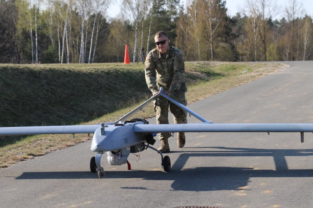 Pfc. Allex Madsen, an unmanned aircraft systems repairer for Company D, 588th Brigade Engineer Battalion, 3rd Armored Brigade Combat Team, 4th Infantry Division, rolls an RQ-7B Shadow off the runway after a flight to refuel for further operations as part of Atlantic Resolve training at Rose Barracks, Vilseck, Germany, April 9, 2017. The brigade UAS platoon is integrating with maneuver and field artillery units to provide route reconnaissance, target acquisition and over-watch for ground troops on the battlefield.
