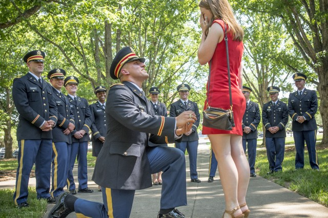Brand new 2nd Lt. Allen Robertson proposes to his girlfriend, Chelsea Campbell, immediately after his Clemson University Reserve Officers' Training Corps commissioning ceremony, May 10, 2017. The two met while they were students at Clemson and will both graduate this week. Robertson, who hails from Mooresville, N.C., earned a degree in accounting at Clemson and his first duty station will be with at Fort Campbell, Ky. with the 101st Airborne Division. Campbell, of Fort Mill, S.C., earned her degree in psychology.