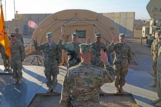 Maj. Gen. Martin reenlists four Soldiers during a battlefield circulation