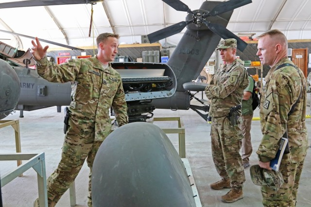 Maj. Gen. Martin talks with a Soldier about an aircraft during a battlefield circulation