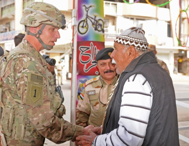 Maj. Gen. Martin talks with an elderly resident of East Mosul during a trip to Mosul