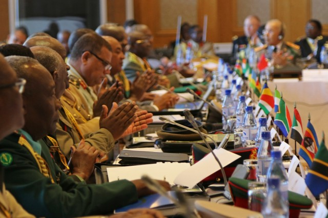 Senior military leaders from countries across the African continent applaud during an introductory session before the opening ceremony of the African Land Forces Summit 2017, in Lilongwe, Malawi, May 8, 2017. ALFS is an annual, weeklong seminar bringing together land force chiefs from across Africa for candid dialog to discuss and develop cooperative solutions to regional and transregional challenges and threats. (U.S. Army photo by Sgt. Paige Behringer)