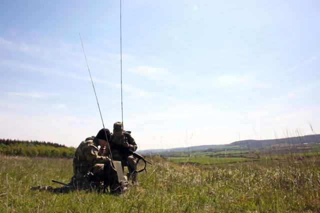 U.S. Army Soldiers assigned to the 44th Expeditionary Signal Battalion, 2nd Theater Signal Brigade, conduct an HF radio communications check during exercise Heavy METL II May 10, 2017 near Illesheim, Germany.
