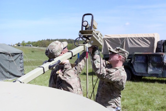 U.S. Army Soldiers assigned to the 44th Expeditionary Signal Battalion, 2nd Theater Signal Brigade, set up a SNAP terminal during exercise Heavy METL II May 10, 2017 near Illesheim, Germany.