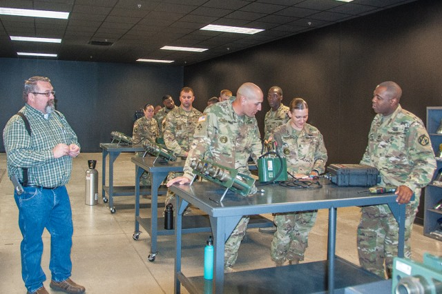 Lloyd Nash Jr., training instructor at the Training Support Center, instructs drill sergeants on the Improvised Explosives Device Effects Simulator Increment 1.
