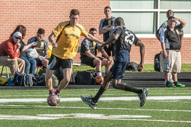Matt Fernandez of the USA team dribbles around a World player in the first half of the annual USA versus the World soccer game Friday at Waynesville Middle School. Fernandez scored the final goal of the match to secure a USA victory 3-1.