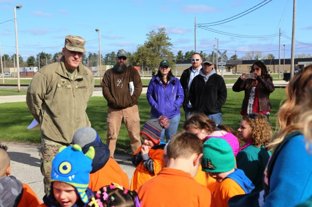 Fort McCoy Garrison Commander Col. David J. Pinter Sr. talks with adults and children from the Fort McCoy community during the installation observance of Arbor Day on April 28, 2017, at Fort McCoy, Wis. More than 30 people participated in the event that included a presentation of the 28th consecutive Tree City USA award for Fort McCoy as well as the planting of 320 trees along the cantonment area fence line. (U.S. Army Photo by Scott T. Sturkol, Public Affairs Office, Fort McCoy, Wis.)