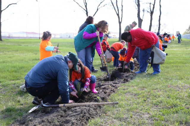 Adults and children from the Fort McCoy community plant trees during the installation observance of Arbor Day on April 28, 2017, at Fort McCoy, Wis. More than 30 people participated in the event that included a presentation of the 28th consecutive Tree City USA award for Fort McCoy as well as the planting of 320 trees along the cantonment area fence line. (U.S. Army Photo by Scott T. Sturkol, Public Affairs Office, Fort McCoy, Wis.)