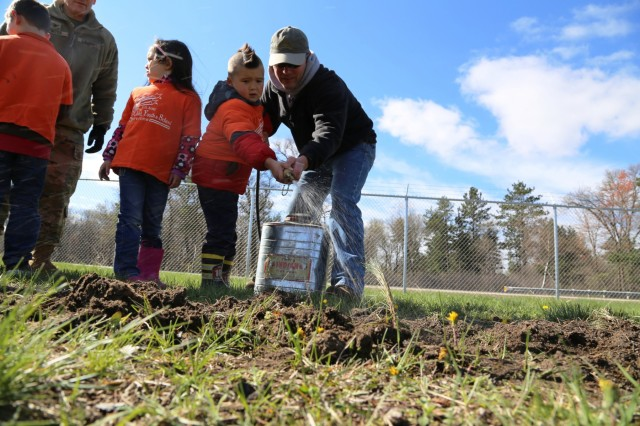 Children from the Fort McCoy community take turns to water freshly planted trees during the installation observance of Arbor Day on April 28, 2017, at Fort McCoy, Wis. More than 30 people participated in the event that included a presentation of the 28th consecutive Tree City USA award for Fort McCoy as well as the planting of 320 trees along the cantonment area fence line. (U.S. Army Photo by Scott T. Sturkol, Public Affairs Office, Fort McCoy, Wis.)