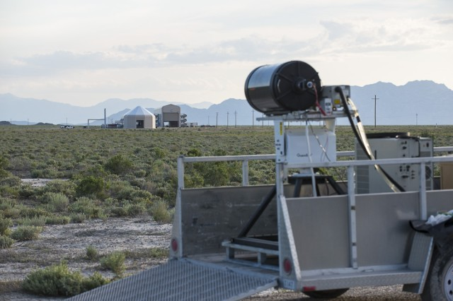 A standoff biological detector looks down the length of the open-ended Active Standoff Chamber (left) or Joint Ambient Breeze Tunnel at Dugway Proving Ground, Utah in 2015. Standoff detectors employ a laser to identify the simulated biological agent, without contamination, and provide early warning. Photo by Jim Robertson, Dugway Proving Ground Optics Branch