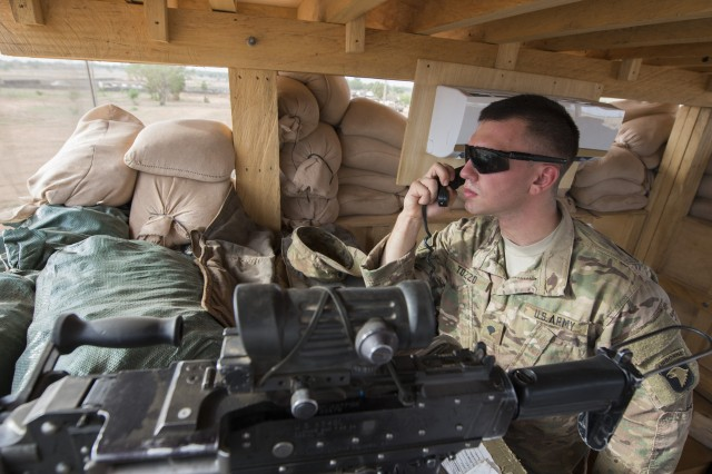 Spc. Dominick Tozzo, an infantryman with the 101st Airborne Division-led task force, talks on the radio while pulling security from an observation post at Contingency Location Garoua in northern Cameroon, April 23, 2017.