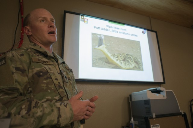 Spc. Warren Stuart, a combat medic with the 101st Airborne Division-led task force, gives a safety briefing on the venomous snakes typically found in or around Contingency Location Garoua in northern Cameroon, April 23, 2017. Stuart, a former South African park ranger, uses his expertise on African snakes to keep Soldiers safe during their time at the outpost.