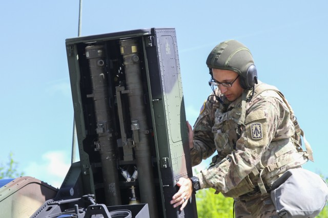 Spc. Bradley Muszalski, an air and missile defense crewmember assigned to Battery C, 2nd Battalion, 44th Air Defense Artillery Regiment, 101st Airborne Division (Air Assault) Sustainment Brigade, 101st Abn. Div., closes the door to a missile launcher pod, April 25, 2017, during missile upload and download crew drill on Fort Campbell, Kentucky. Muszalski conducted the drills as part of his battery's field training exercise. (U.S. Army photo by Sgt. Neysa Canfield/101st Airborne Division Sustainment Brigade Public Affairs)