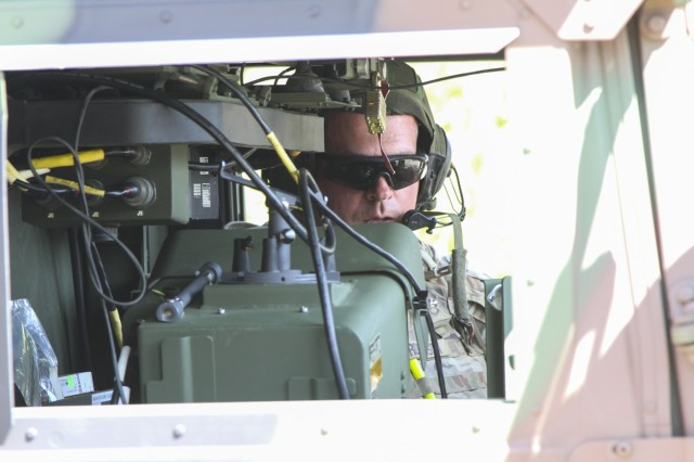 Staff Sgt. Josh Robinson, an air and missile defense crewmember assigned to Battery C, 2nd Battalion, 44th Air Defense Artillery Regiment, 101st Airborne Division (Air Assault) Sustainment Brigade, 101st Abn. Div., reports the status of his crew, April 25, 2017, during a missile upload and download crew drill on Fort Campbell, Kentucky. (U.S. Army photo by Sgt. Neysa Canfield/101st Airborne Division Sustainment Brigade Public Affairs)