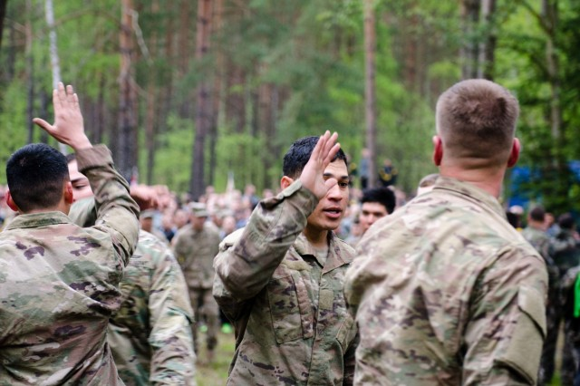 Members of the U.S. Army team celebrate after completing the obstacle course during the Strong Europe Tank Challenge at Grafenwoehr Training Area, May 12, 2017. The Strong Europe Tank Challenge was co-hosted by U.S. Army Europe and the German Army, May 7-12, 2017. The Competition was designed to test capabilities, project a dynamic presence, foster military partnership, promote interoperability, and provide an environment for sharing tactics, techniques and procedures.