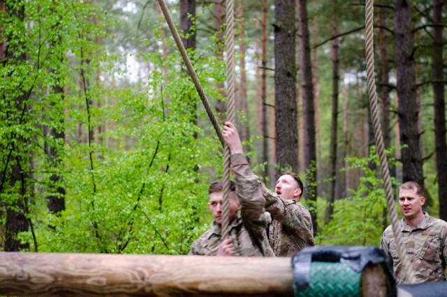A member of the U.S. Army team celebrates after completing the obstacle course during the Strong Europe Tank Challenge at Grafenwoehr Training Area, May 12, 2017. The Strong Europe Tank Challenge was co-hosted by U.S. Army Europe and the German Army, May 7-12, 2017. The Competition was designed to test capabilities, project a dynamic presence, foster military partnership, promote interoperability, and provide an environment for sharing tactics, techniques and procedures.