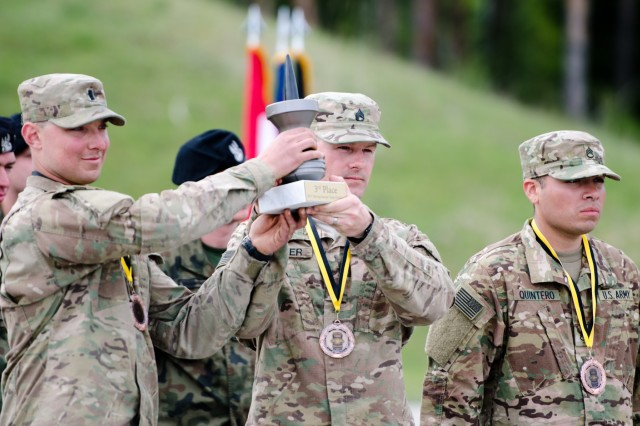Members of the U.S. team from the Strong Europe Tank Challenge present their third place trophy at Grafenwoehr Training Area, May 12, 2017. The Strong Europe Tank Challenge was co-hosted by U.S. Army Europe and the German Army, May 7-12, 2017. The Competition was designed to test capabilities, project a dynamic presence, foster military partnership, promote interoperability, and provide an environment for sharing tactics, techniques and procedures.