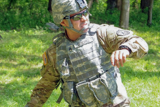 Staff Sgt. Humberto Gutierrez, Headquarters and Headquarters Company, 780th Military Intelligence Brigade, throws a smoke grenade to mark a helicopter landing zone in order to evacuate a casualty as part of the 2017 U.S. Army Intelligence & Security Command North Region Best Warrior Competition events at Gunpowder Military Reservation, Maryland, May 10.