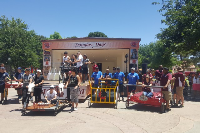 The Raymond W. Bliss Army Health Center team holds up their second-place trophy from the Douglas Days Bed Race May 13 in Douglas, Arizona.