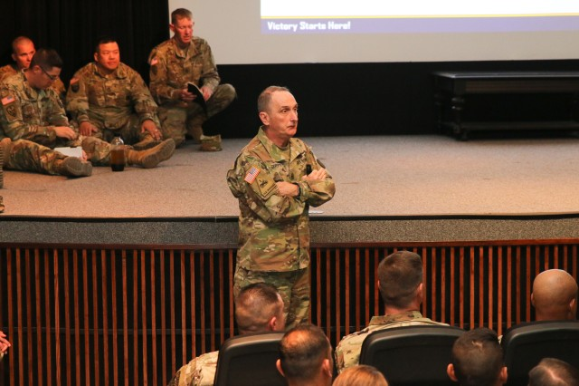 Command Sgt. Maj. David Davenport, U.S. Army Training and Doctrine Command senior enlisted leader, takes a question from a Soldier in the audience during his NCO professional development session April 25 at Fitch Auditorium during NCO Week at Fort Huachuca.  (Photo Credit: Fort Huachuca Public Affairs Lara Poirrier)