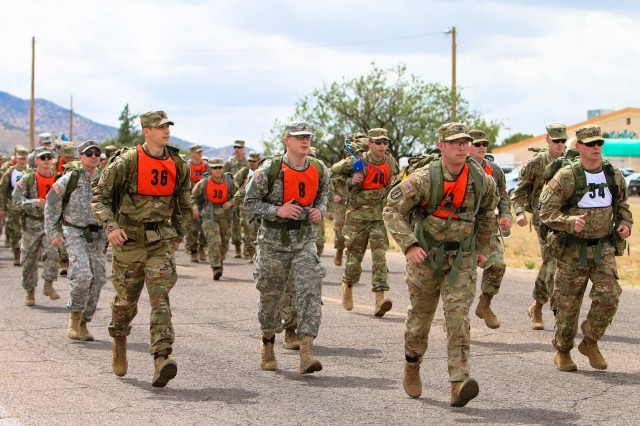 NCOs start the 7.5-mile ruck march, which also served as the final qualifier for the German Armed Forces Badge for Military Proficiency, April 28 at the Thunder Mountain Activity Centre, Fort Huachuca.  (Photo Credit: Fort Huachuca Public Affairs Lara Poirrier)