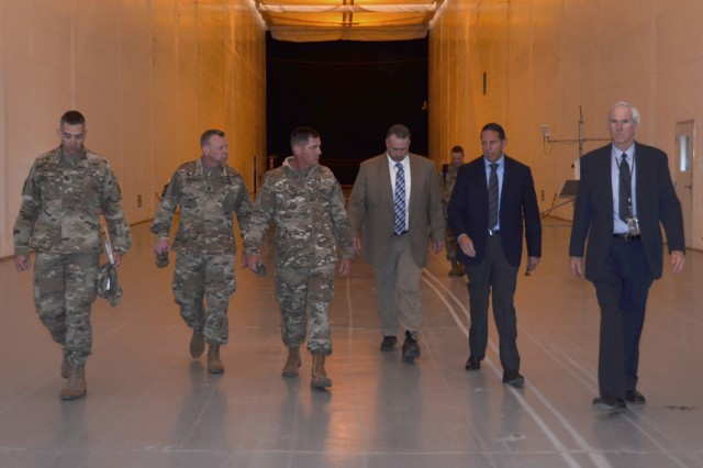 Walking inside the Joint Ambient Tunnel April 26 at U.S. Army Dugway Proving Ground is (L to R) Col. Sean Kirschner, commander, Dugway Proving Ground; Army Test & Evaluation Command, Command Sgt. Major Andrew B. Connette; ATEC Commanding General Maj. Gen. John W. Charlton; Ryan Harris, director, West Desert Center; Jeff Garcia, chief of the Test Support Division; and Gary Millar, branch chief of the Test Support Division. The JABT tests standoff detectors for chemical and biological defense testing by maintaining the same temperature and humidity as the outside temperature, but within a controlled environmental space. Photo by Bonnie A. Robinson, Dugway Public Affairs