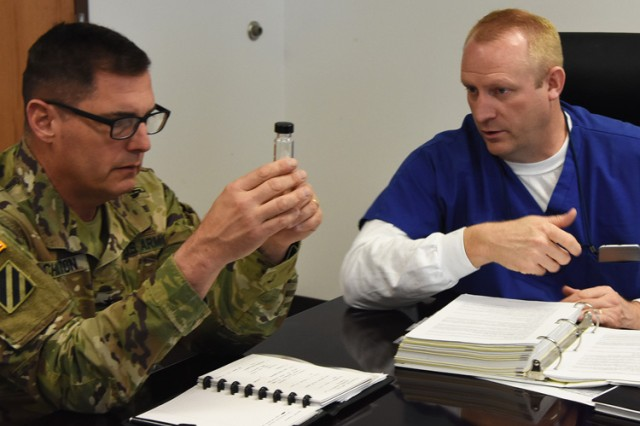 Maj. Gen. John Charlton, commander of Army Test and Evaluation Command, visited Dugway Proving Ground, Utah in April 2017 to learn how defenses against chemical agent are tested. Here, Charlton learns how small vials of chemical agent are shipped in multi-layered stainless steel containers. Photo by Al Vogel, Dugway Public Affairs