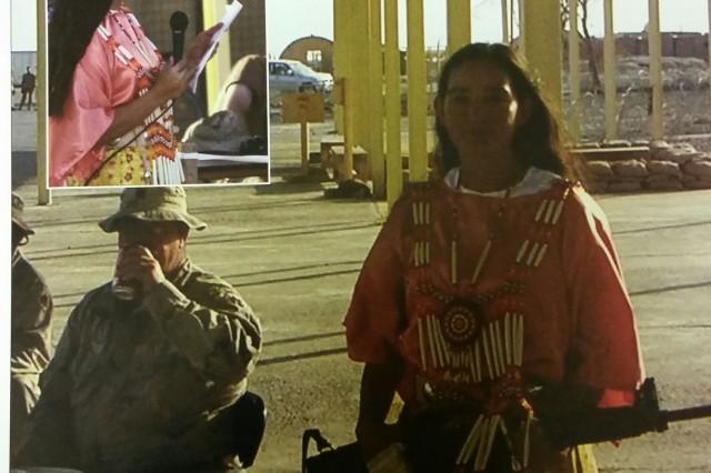Sgt. Debra Kay Mooney seen here in Choctaw dress, organizes a pow-wow in Fallujah, Iraq, 2004.