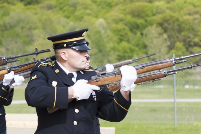 """Army Spc. Stephen Drolet, a Soldier in the Massachusetts National Guard, takes aim with a rifle during the 80-hour, Train-the-trainer Military Funeral Honors course at Camp Smith Training Site May 11, 2017. Twelve Army National Guard Soldiers from the Northeast region were selected to attend the two-week training from May 8-19, 2017, which is designed to """"train the trainer"""" so current Honor Guard members can return as state level training instructors. The training prepares each Soldier to execute the six different positions in a military funeral detail."""