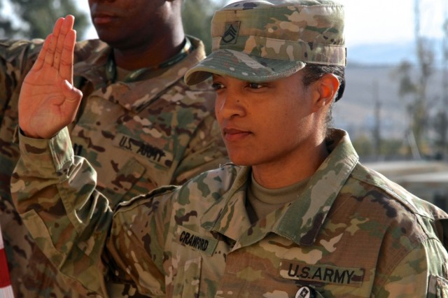Photo By Staff Sgt. Jared Crain | Staff Sgt. Christal Crawford, USARCENT broadcast specialist, takes the oath of enlistment, May 5, 2017, during exercise Eager Lion in Jordan.