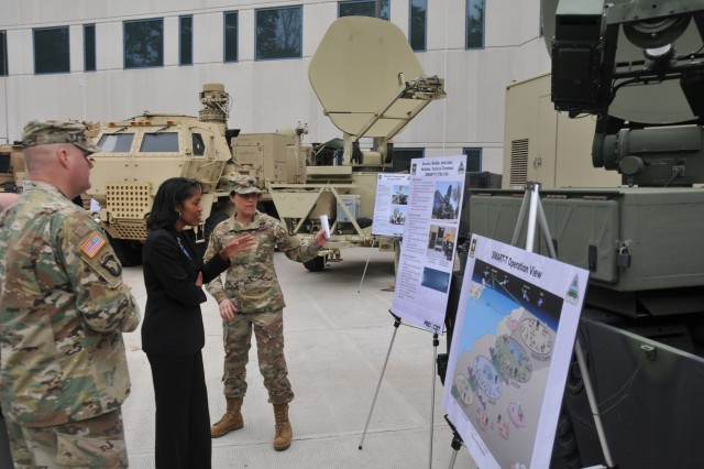 Lt. Col. Jenny Tam (right), product manager for Satellite Communications, briefs Steffanie B. Easter, the senior official performing the duties of the Assistant Secretary of the Army for Acquisition, Logistics and Technology, during her visit to Aberdeen Proving Ground, Maryland, May 11, 2017.