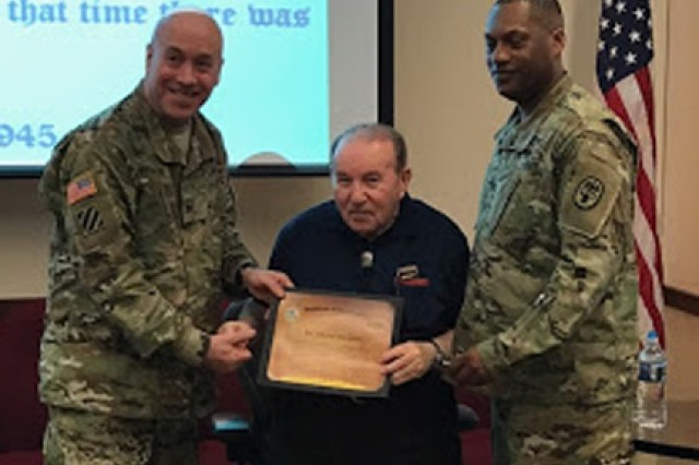 Col. David S. Oeschger and Sgt. Maj. Lawrence D. Jordan present Holocaust survivor Michel Margosis with a certificate of appreciation for speaking to Army Wounded Warrior staff during Equal Opportunity training.