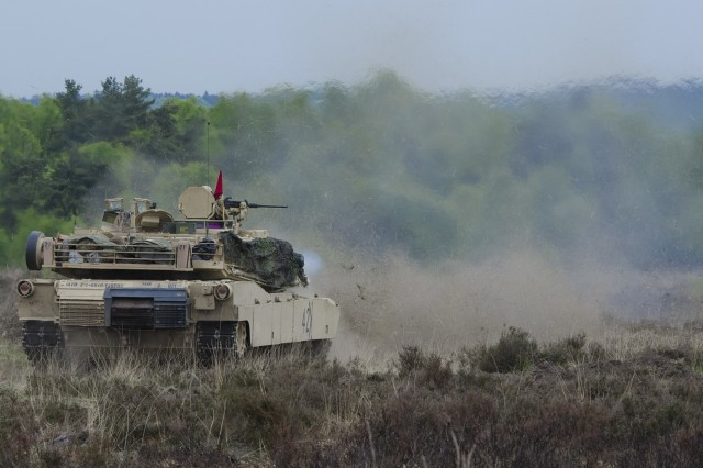 A U.S. M1A2 Abrams main battle tank conducts a combined live-fire training during the German led exercise Haffschild, at training area Bergen-Hohne, May 16, 2017. Maintaining combat readiness is a top priority for the 3rd ABCT. Training alongside NATO Allies and partners, as part of Operation Atlantic Resolve, provides unique opportunities to sharpen skills and sustain the ability to shoot, move and communicate as a combined arms team. (U.S. Army photo by Sgt. Justin Geiger)