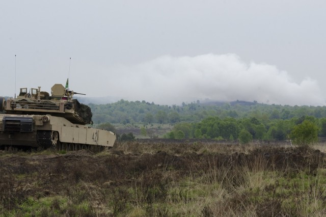 A U.S. M1A2 Abrams main battle tank scans its sector for targets during the German led exercise Haffschild, at training area Bergen-Hohne, May 16, 2017. Maintaining combat readiness is a top priority for the 3rd ABCT. Training alongside NATO Allies and partners, as part of Operation Atlantic Resolve, provides unique opportunities to sharpen skills and sustain the ability to shoot, move and communicate as a combined arms team. (U.S. Army photo by Sgt. Justin Geiger)