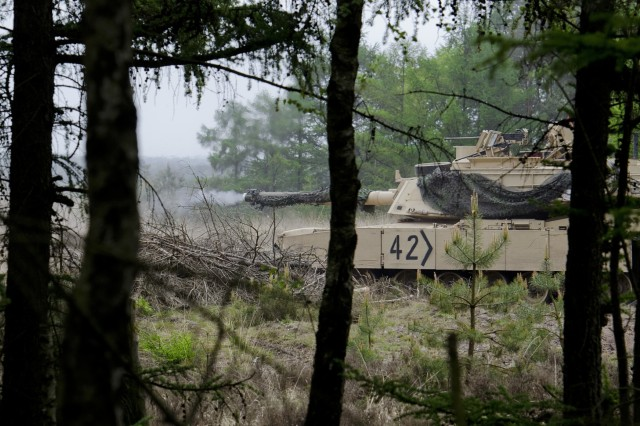 A U.S. M1A2 Abrams main battle tank engages a target during the German led exercise Haffschild, at training area Bergen-Hohne, May 16, 2017. Maintaining combat readiness is a top priority for the 3rd ABCT. Training alongside NATO Allies and partners, as part of Operation Atlantic Resolve, provides unique opportunities to sharpen skills and sustain the ability to shoot, move and communicate as a combined arms team. (U.S. Army photo by Sgt. Justin Geiger)