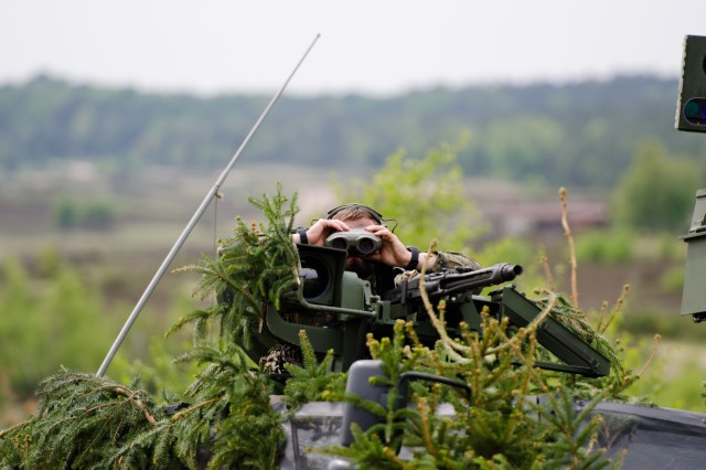 A German Joint Terminal Attack Controller observes artillery fire during the Combined Arms Live-Fire Exercise portion of the German led exercise Haffschild, at training area Bergen-Hohne, May 16, 2017. The U.S. Army Europe exercise provides the opportunity for Allies to train side-by-side, strengthening the relationship and demonstrating the U.S. commitment to NATO. (U.S. Army photo by Capt. John W. Strickland)