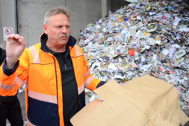 Ernst recycling facility supervisor Manfred Ortner serves as tour guide during a U.S. Army Garrison Ansbach environmental field trip to a waste sorting facility in Markt Berolzheim, Germany, April 28, 2017.