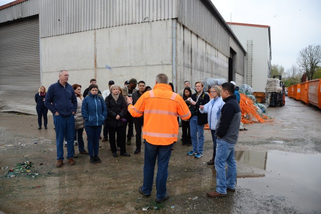 Ernst recycling facility supervisor Manfred Ortner, center, serves as tour guide during a U.S. Army Garrison Ansbach environmental field trip to a waste sorting facility in Markt Berolzheim, Germany, April 28, 2017.