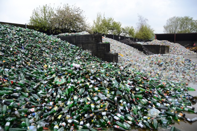 Pictured are piles of thousands of glass bottles ready for further separation at a waste sorting and recycling facility in Markt Berolzheim, Germany. Community members from USAG Ansbach visited the facility as part of an environmental field trip April 28, 2017.